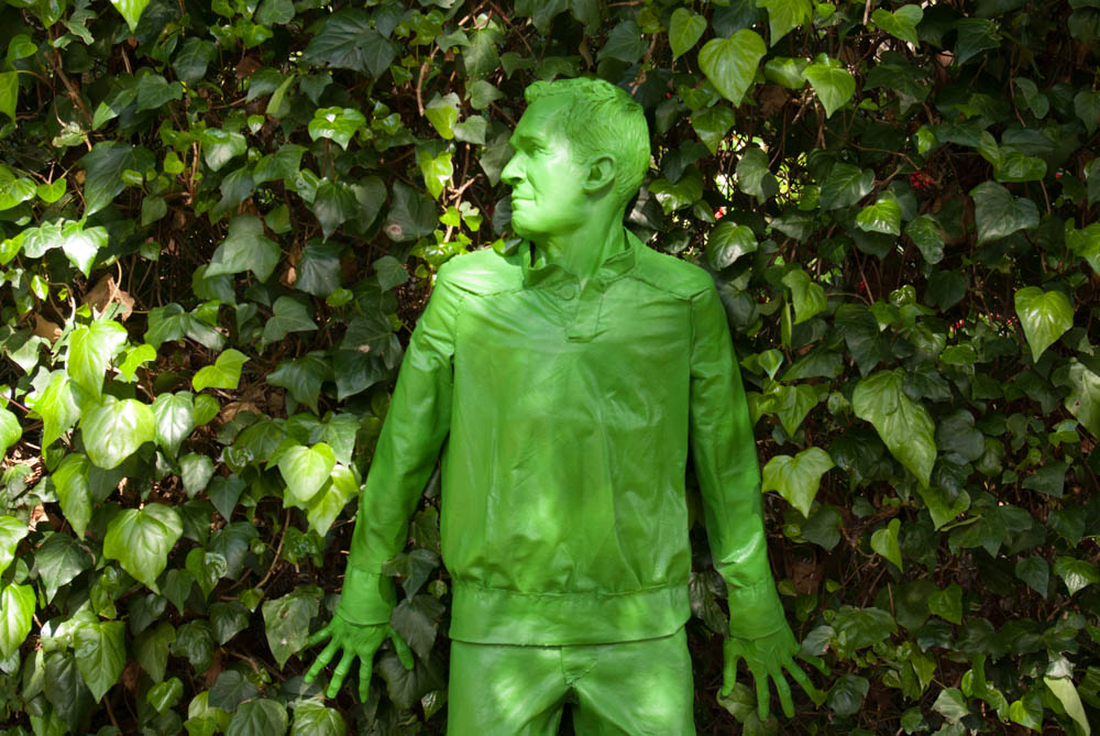 green man hiding
